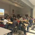 Families gather at Little Mill Middle School for a Common Table Dinner. (Credit: Kim DeRose)
